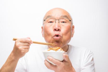 Senior eating Japanese natto