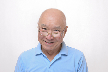 Senior Japanese smile reading glasses. Stock Photo