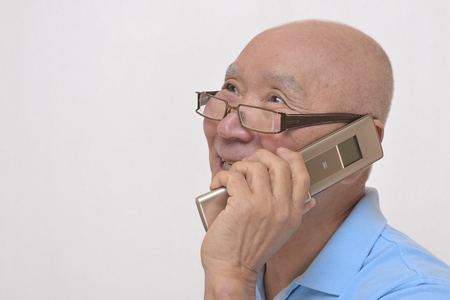 Japanese senior Smile on the phone