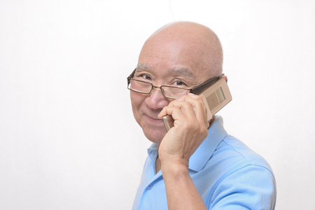 Senior Japanese smile talking on cell phones Stock Photo