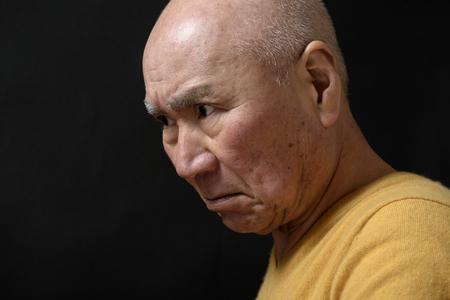 Senior enraged face 写真素材