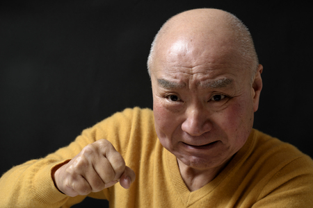 Senior enraged face Stock Photo