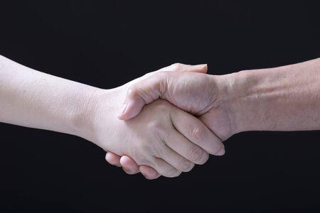 Shaking hands between men and women 写真素材 - 97793813