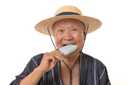 Senior eats ice pops