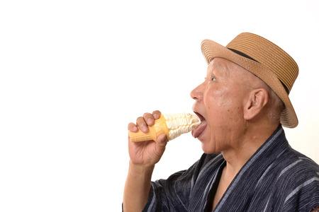 Senior eating soft serve ice cream