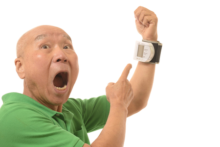 Blood pressure measurement of a senior Stock fotó