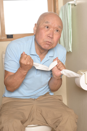 Seniors suffer from constipation on the toilet 写真素材