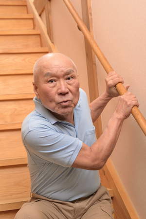 Senior up and down the stairs 스톡 콘텐츠