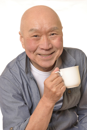Senior drinking coffee with a smile