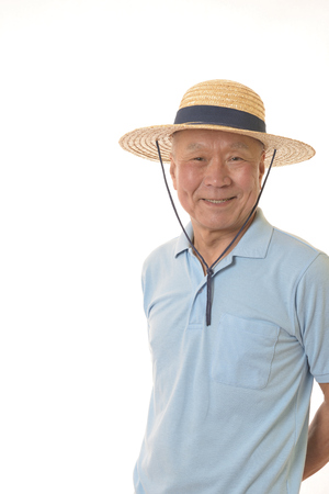 Senior smiles and straw hat