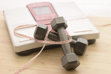 Dumbbell and weight scales and tape measures 写真素材