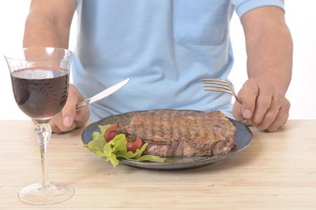 Senior eat steak. 写真素材