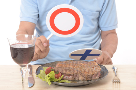 Steak before YES NO placard