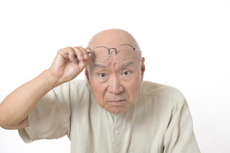 Presbyopia Senior Men Stock Photo
