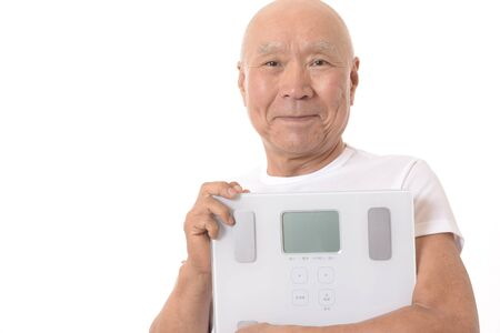 Japanese Senior with Scale Archivio Fotografico - 133804515