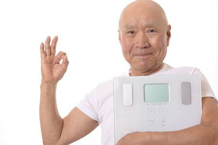 Japanese Senior with Scale Archivio Fotografico - 133804536