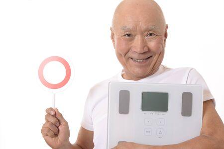 Japanese Senior with Scale Archivio Fotografico - 133804542