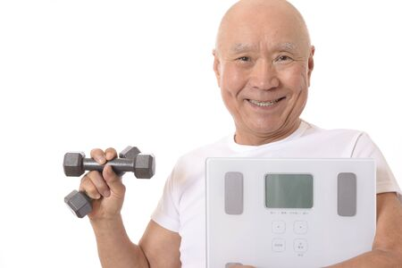 Senior with scale and dumbbell