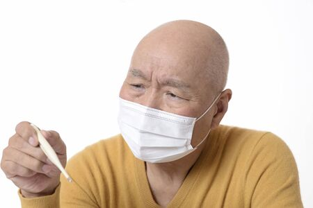 Japanese seniors measuring body temperature with infectious diseases