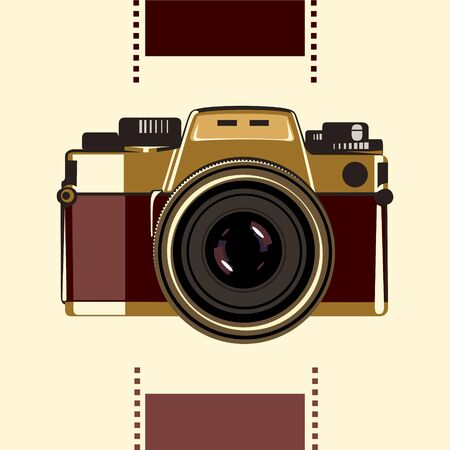 An old-school photo camera in gold-vinous colors