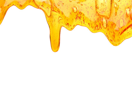 Honey dripping from a wooden honey ..