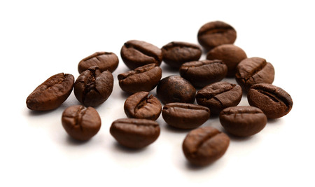 Coffee beans are isolated on a white background