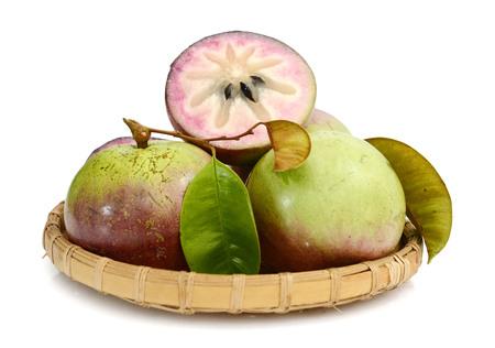 白い背景で隔離星リンゴやカイの胸のミルク cainito フルーツ