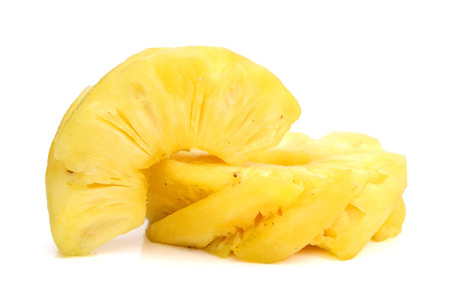 Pineapple with slices on a white background, fruit.