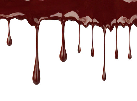 Chocolate syrup drips isolated on white