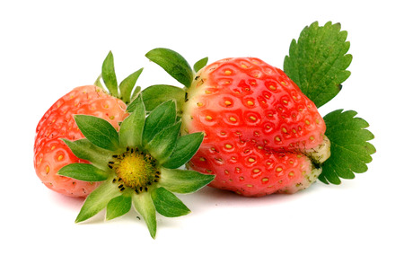 Strawberries macro with leaves isolated on white