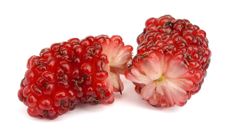 Group of mulberries with leaves isolated on white background. Mulberry is a fruit and can be eaten.