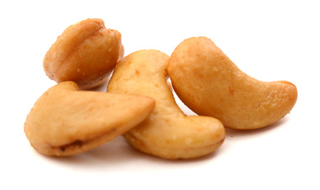 salted cashew nuts on white background