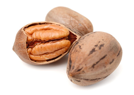 Pecan nuts close up, isolated on white Stock Photo