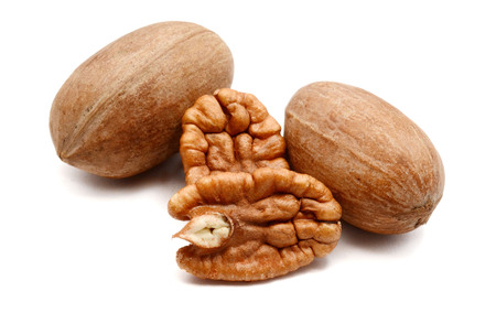 Pecan nuts isolated over white background 免版税图像