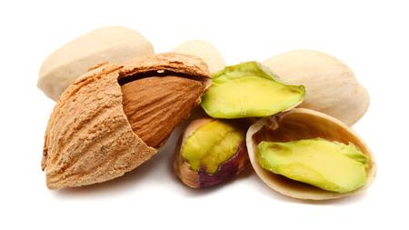 Pile of fruit Pistachios isolated on white background