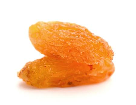 Healthy golden raisins isolated on white