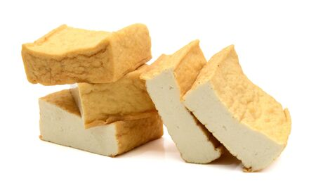 Homemade fried tofu over white background