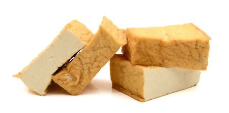 tofu blocks isolated on white Фото со стока