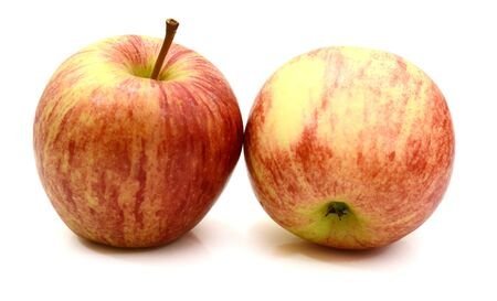 Apple (Evelina variety) and one slice isolated on white background red yellow fresh Stok Fotoğraf - 129218232