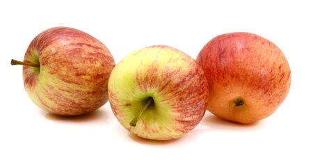 Apples (Evelina variety) isolated on white background one whole red yellow with stem and one half Stok Fotoğraf - 129218238