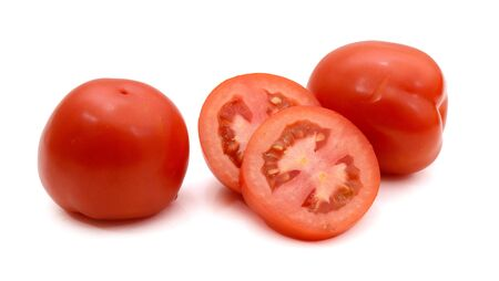 Two red tomato and one half isolated on white background 免版税图像