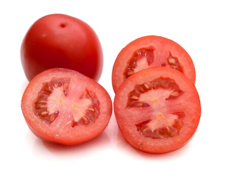 bunch of mixed red and yellow cherry and italian tomatoes and some halves on a white background Stok Fotoğraf - 129218418