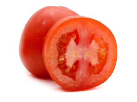 fresh and colorful italian roma tomato slices on a white background