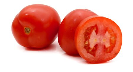 fresh and colorful italian roma tomatoes and cut some slices on a white background Stok Fotoğraf - 129218832