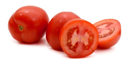 fresh and colorful italian roma tomatoes and cut some slices on a white background