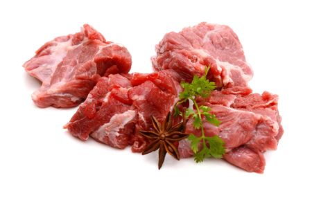 Cut of beef steak with green leaf. Isolated.