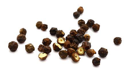 heap of black peppercorns on white background