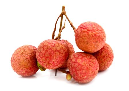 fresh lychees on white background