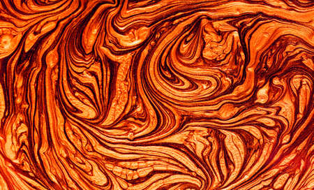 Fluid Art. Abstract Golden curl and lines on brown waves. Marbling background or texture.