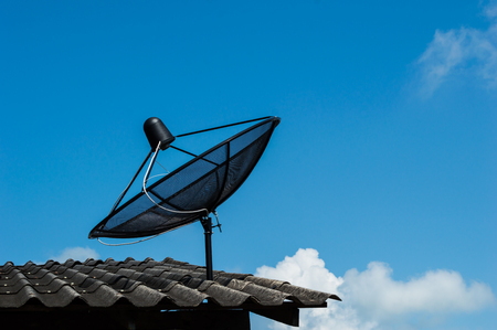 Satellite dish on the roof of the house  photo